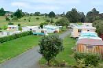 Clarks Beach Holiday Park, Powered Site - All Weather